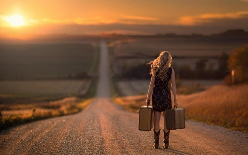 girl-walking-suitcases